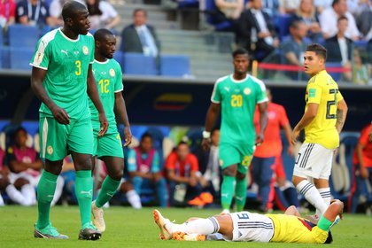Soccer Football – World Cup – Group H – Senegal vs Colombia – Samara Arena, Samara, Russia – June 28, 2018   Colombia's Radamel Falcao reacts as Senegal's Kalidou Koulibaly looks on during the match   REUTERS/Marcos Brindicci