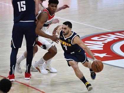 Facundo Campazzo beats Rui Hachimura during the Denver Nuggets-Washington Wizards game (Mandatory Credit: Brad Mills-USA TODAY Sports)