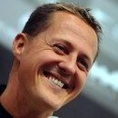 zzzzinte1Seven-times F1 world champion Michael Schumacher responds to questions in Beijing on November 3, 2009. Beijing's iconic Bird's Nest Stadium has been turned into a motor racing track with the world's top drivers gearing up to compete 2009 Race of Champions. AFP PHOTO/Frederic J. BROWNzzzz