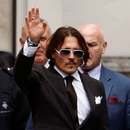 Actor Johnny Depp gestures as he leaves the High Court in London, Britain July 10, 2020. REUTERS/Peter Nicholls