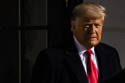 U.S. President Donald Trump departs the White House in Washington, D.C., U.S., on Tuesday, Jan. 12, 2021. Trump plans to tout completed sections of his border wall in Texas on Tuesday, his first public event since encouraging supporters who went on to attack the U.S. Capitol last week. Photographer: Samuel Corum/Bloomberg