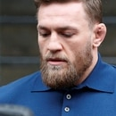 MMA fighter Conor McGregor walks out of the 78th police precinct after charges were laid against him following a late night melee in the Brooklyn borough of New York City, New York, U.S., April 6, 2018. REUTERS/Brendan McDermid