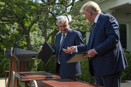 El documento se firmó por duplicado en los idiomas inglés y español, añade el texto. (Foto: JIM WATSON / AFP)