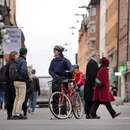 People talk on a street in the Sodermalm district, as the spread of the coronavirus disease continues (COVID-19) in Stockholm, Sweden April 1, 2020. TT News Agency/Jessica Gow via REUTERS ATTENTION EDITORS - THIS IMAGE WAS PROVIDED BY A THIRD PARTY. SWEDEN OUT. NO COMMERCIAL OR EDITORIAL SALES IN SWE