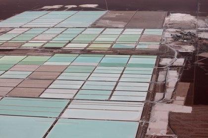 Aerial archival image of the brine pools at SQM's lithium mine in the Atacama desert, Chile.  January 10, 2013. REUTERS / Iván Alvarado