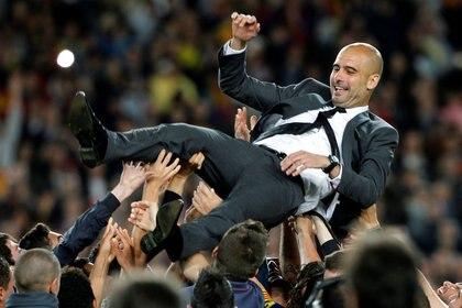 Pep Guardiola ha ganado 14 títulos en cuatro años como DT del Barça y es uno de los símbolos del club (REUTERS)