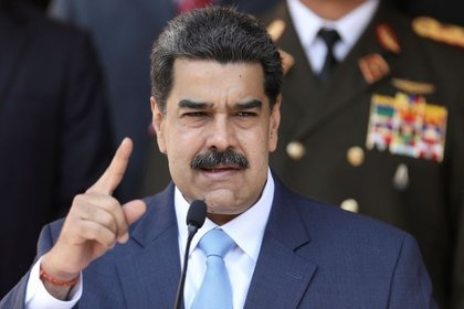 FOTO DE ARCHIVO: El dictador de Venezuela, Maduro, realiza una conferencia de prensa en el Palacio de Miraflores en Caracas, Venezuela, Marzo 12, 2020. (REUTERS/Manaure Quintero/Foto de Archivo)