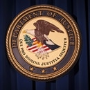 FILE PHOTO: The Department of Justice (DOJ) logo is pictured on a wall after a news conference to discuss alleged fraud by Russian Diplomats in New York December 5, 2013. REUTERS/Carlo Allegri/File Photo
