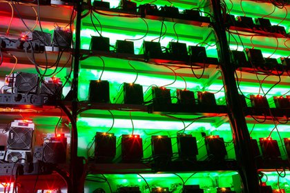 Illuminated racks of application-specific integrated circuit (ASIC) mining devices and power units at the BitCluster cryptocurrency mining farm in Norilsk, Russia, on Sunday, Dec. 20, 2020. Norilsk may soon be famous for a different type of mining — it now hosts the Arctic's first crypto farm for producing new Bitcoins. Photographer: Andrey Rudakov/Bloomberg