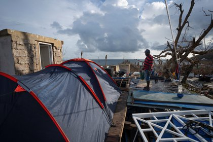 A man looks at some armed tents in the middle of the rubble of his house after the passage of Storm Iota, in Providencia, Colombia November 23, 2020. Picture taken November 23, 2020. REUTERS/Nathalia Angarita NO RESALES. NO ARCHIVES