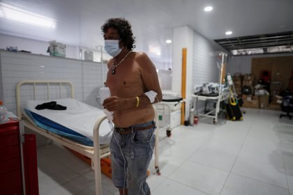 A man wearing a face mask due to the outbreak of the coronavirus disease (COVID-19), walk through an improvised hospital within the Providencia city hall, after the passage of Storm Iota, in Providencia, Colombia November 22, 2020. Picture taken November 22, 2020. REUTERS/Nathalia Angarita NO RESALES. NO ARCHIVES