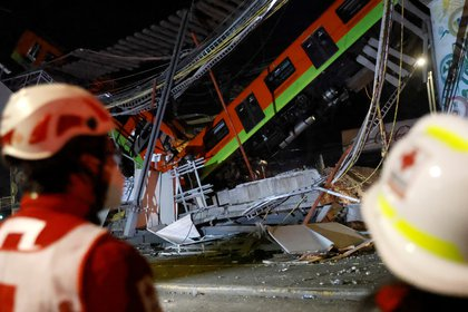 The site where an overpass for a metro partially collapsed with train cars on it is seen at Olivos station in Mexico City, Mexico May 4, 2021. REUTERS/Carlos Jasso