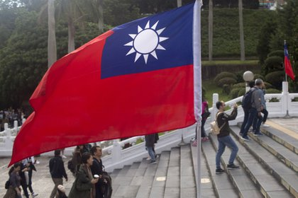 A Taiwan flag stands at the National Palace Museum in Taipei, Taiwan, on Friday, Dec. 29, 2017. Taiwan's currency rose 18 percent in 2017, its best annual performance in three decades, largely the result of a weakening greenback. Photographer: Brent Lewin/Bloomberg