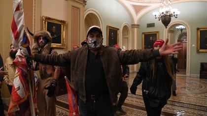 Los fiscales creen que los invasores querían secuestrar y asesinar a congresistas (Photo by Saul LOEB / AFP)