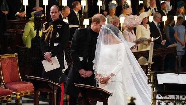 El príncipe Harry y la estadounidense Meghan Markle se convirtieron en los duques de Sussex (AFP)
