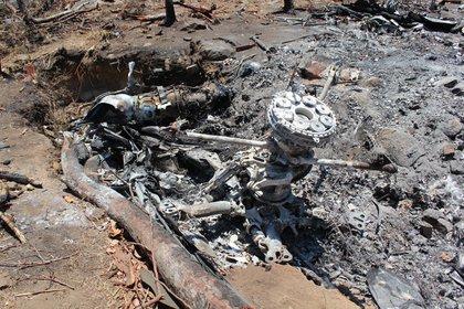 Los restos del helicóptero de la Sedena derribado por el CJNG (Foto: Cuartoscuro)