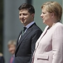 German Chancellor Angela Merkel, right, stands next to Ukraine's President Volodymyr Zelenskiy with military honors for a meeting at the chancellery in Berlin, Germany, Tuesday, June 18, 2019. (AP Photo/Michael Sohn)
