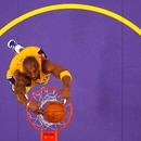 FILE PHOTO: Los Angeles Lakers Kobe Bryant slam dunks against the Sacramento Kings during their NBA basketball game in Los Angeles, California, January 28, 2011. REUTERS/Lucy Nicholson/File Photo