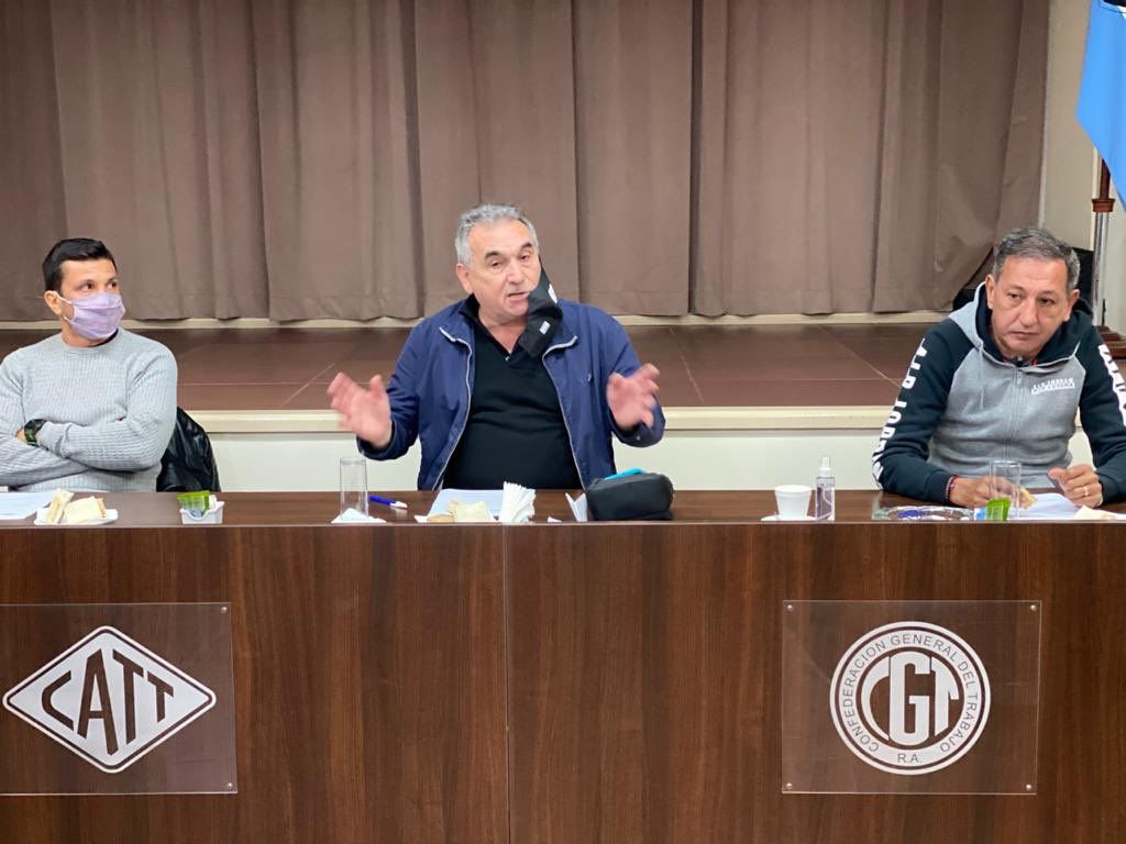 Juan Pablo Brey, Juan Carlos Schmid y Omar Maturano, sindicalistas de la Confederación de Trabajadores del Transporte (CATT)