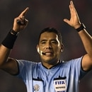 Peruvian referee Diego Haro gestures during the Copa Sudamericana quarterfinal fisrt leg football match between Argentina's Independiente and Ecuador's Independiente del Valle at Libertadores de America stadium in Avellaneda, Buenos Aires on August 6, 2019. (Photo by JUAN MABROMATA / AFP)