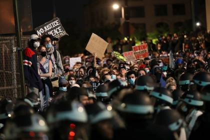 People demonstrate in front of the police