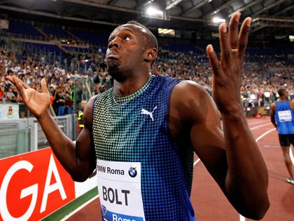 FILE PHOTO: ON THIS DAY -- June 6  June 6, 2013     ATHLETICS - Usain Bolt reacts after finishing second behind Justin Gatlin in the 100 metres race at the Rome Golden Gala Diamond League meeting.     American Gatlin, a bronze medallist at the London 2012 Olympics following his four-year doping ban, finished the race in 9.94 seconds to edge out Bolt by 0.01 seconds.     Bolt, 33, currently holds the world record in the 100 metres, 200 metres and 4x100 metres relay. REUTERS/Giampiero Sposito/File Photo