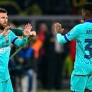 Barcelona's Argentine forward Lionel Messi (L) substitutes Barcelona´s Guinea-Bissau forward Ansu Fati (R) during the UEFA Champions League Group F football match Borussia Dortmund v FC Barcelona in Dortmund, western Germany, on September 17, 2019. (Photo by SASCHA SCHUERMANN / AFP)