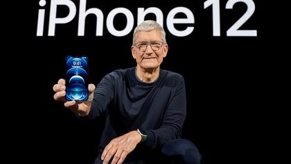 Apple CEO Tim Cook poses with the all-new iPhone 12 Pro at Apple Park in Cupertino, California, U.S. in a photo released October 13, 2020.  Brooks Kraft/Apple Inc./Handout via REUTERS NO RESALES. NO ARCHIVES. THIS IMAGE HAS BEEN SUPPLIED BY A THIRD PARTY.     TPX IMAGES OF THE DAY