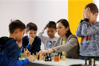 Dinara Saduakassova, a 23-year-old Kazakh chess player and social activist, teaches children in the Chess Academy she founded in Nur-Sultan, Kazakhstan March 3, 2020. Saduakassova has opened a chain of chess schools in the country and has become a Goodwill Ambassador of the UNICEF. REUTERS/Pavel Mikheyev