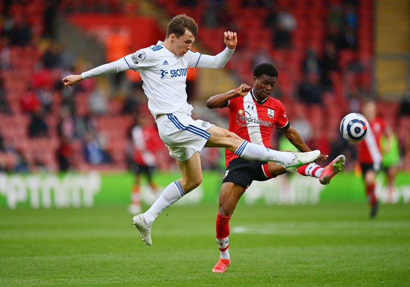 FILE PHOTO: Soccer Football - Premier League - Southampton v Leeds United - St Mary's Stadium, Southampton, Britain - May 18, 2021 Leeds United's Diego Llorente in action with Southampton's Nathan Tella Pool via REUTERS/Dan Mullan