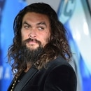 Jason Momoa arrives at the premiere of