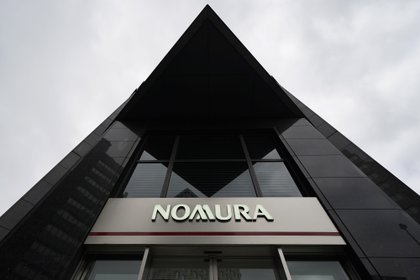 A sign for The Nomura Holdings Inc. is displayed outside a Nomura Securities Co. branch in Tokyo, Japan, on Tuesday, April 23, 2019. Nomura is scheduled to release its full-year earnings on April 25. Photographer: Toru Hanai/Bloomberg