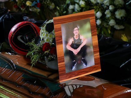 A framed photo of Alexander Martinez, a 16-year-old boy who was shot dead by municipal police officers, is placed over his coffin during a wake at his mother's home in the town of Acatlan de Perez Figueroa, in Oaxaca state, Mexico June 11, 2020. Picture taken June 11, 2020. REUTERS/Stringer NO RESALES. NO ARCHIVES