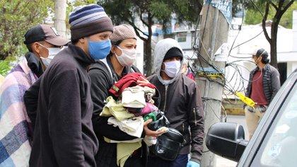 Migrantes venezolanos en Quito (EFE/ Elías L. Benarroch)
