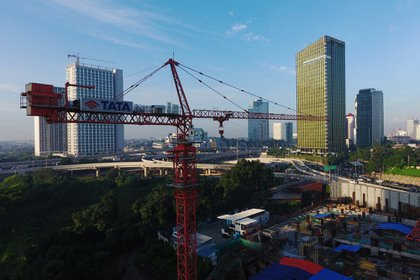 A crane stands at a construction site in this aerial photograph taken in Jakarta, Indonesia, on Friday, Feb. 1, 2019. Indonesia is scheduled to release fourth-quarter gross domestic product (GDP) figures on Feb. 6. Photographer: Dimas Ardian/Bloomberg