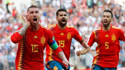 Soccer Football – World Cup – Round of 16 – Spain vs Russia – Luzhniki Stadium, Moscow, Russia – July 1, 2018 Spain's Sergio Ramos celebrates with team mates after Russia's Sergei Ignashevich scored an own goal and the first goal for Spain REUTERS/Carl Recine
