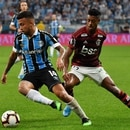 Matheus Henrique (L) of Brazil's Gremio, vies for the ball with Bruno Henrique (R) of Brazil's Flamengo, during their 2019 Copa Libertadores semifinal first leg football match held at Gremio Arena, in Porto Alegre, Brazil, on October 2, 2019. (Photo by NELSON ALMEIDA / AFP)