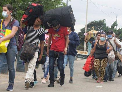 """De los 81 casos """"importados"""", 73 son migrantes que llegaron de Colombia, 4 de Perú, 3 de Ecuador y 1 de Brasil. EFE/Archivo"""