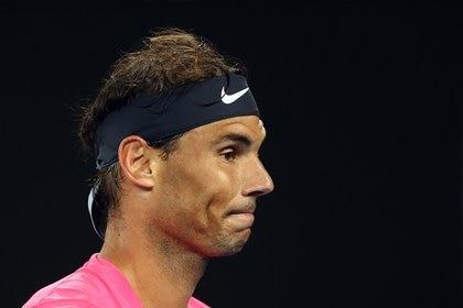 Tennis - Australian Open - Quarter Final - Melbourne Park, Melbourne, Australia - January 29, 2020. Spain's Rafael Nadal reacts during his quarter final match against Austria's Dominic Thiem. REUTERS/Kai Pfaffenbach