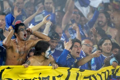 File photo.  Millonarios fans celebrate the closing championship title of the Colombian League after the definition with Independiente Medellín at the El Campín stadium in Bogotá, Colombia, December 16, 2012. REUTERS / John Vizcaino