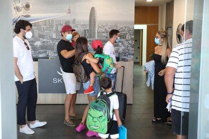Las familias de Messi y Suárez antes de viajar a Ibiza (Grosby)