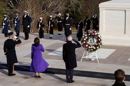 U.S. President Joe Biden, Vice President Kamala D. Harris and Major General Omar J. Jones salute at the Tomb of the Unknown Soldier at the Arlington National Cemetery, in Arlington, Virginia, U.S., January  20, 2021. REUTERS/Joshua Roberts/Pool