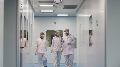 "Lab technicians walk as they work on investigational coronavirus disease (COVID-19) treatment drug ""Remdesivir"" at Eva Pharma Facility in Cairo, Egypt June 25, 2020. REUTERS/Amr Abdallah Dalsh"