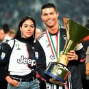 Soccer Football - Serie A - Juventus v Atalanta - Allianz Stadium, Turin, Italy - May 19, 2019 Juventus' Cristiano Ronaldo poses with his partner Georgina Rodriguez as he celebrates winning Serie A with the trophy REUTERS/Massimo Pinca