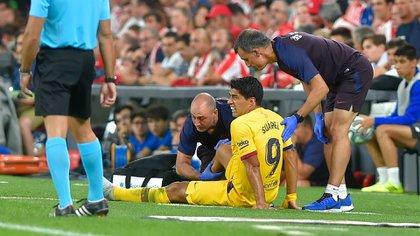 Luis Suárez se lesionó en el primer partido de liga (AFP)
