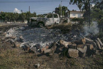 La Secretaría de Seguridad y Protección Ciudadana informó que fueron asesinados 14 de sus elementos durante una emboscada en la comunidad de El Aguaje. (Foto: Cuartoscuro)