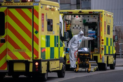 A worker in PPE cleans the inside of an ambulance at the Royal London Hospital. Photographer: Chris J. Ratcliffe/Bloomberg