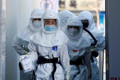 Las autoridades sanitarias extreman las medidas para contener la propagación del coronavirus (Reuters/ Kim Kyung-Hoon)