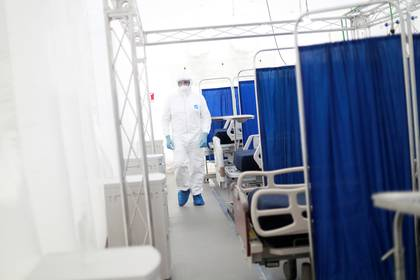 A medical specialist wearing protective gear walks inside the new immediate response mobile hospital with 50 intensive care beds against the outbreak of coronavirus disease (COVID-19) in Pachuca, Hidalgo, Mexico, March 19, 2020. Picture taken March 18, 2020. REUTERS/Henry Romero