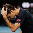 Tennis - Australian Open - Semi Final - Melbourne Park, Melbourne, Australia - January 30, 2020. Switzerland's Roger Federer reacts after his match against Serbia's Novak Djokovic. REUTERS/Issei Kato